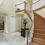 6738994 - foyer in suburban home with curved staircase
